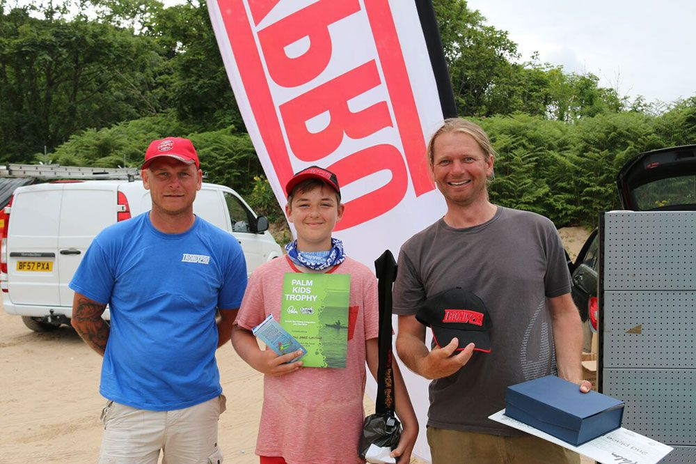 Junior winner Harrison Shaw-Whiting with TronixFishing pro staff Martin Collison (left) and Mark Radcliffe (right)