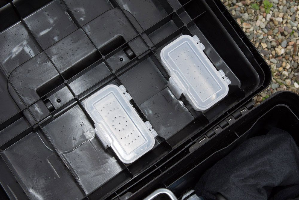 Storage boxes fit neatly into the lid
